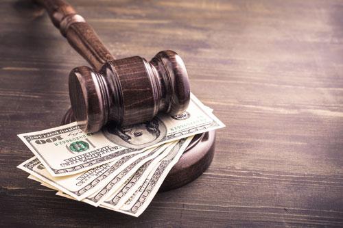 gavel on hundred dollar bills | Colorado law firm