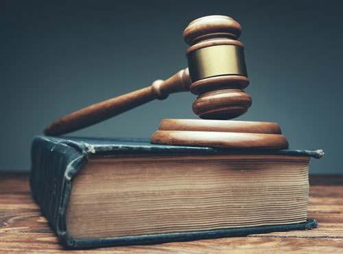 gavel on top of a law book | criminal defense law firm