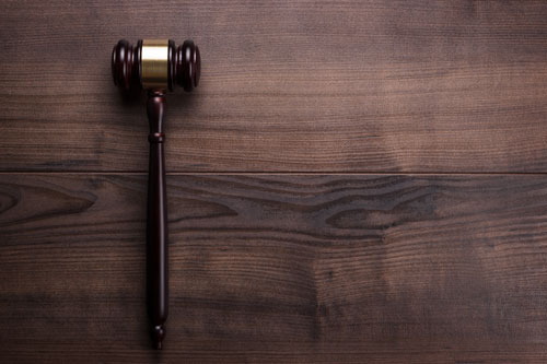 gavel laying on wooden table | crime attorney