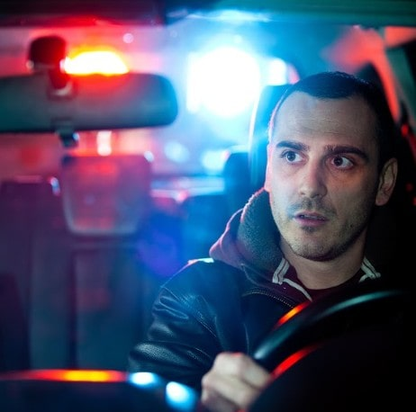 man getting pulled over by a police officer | reasonable suspicion for dui